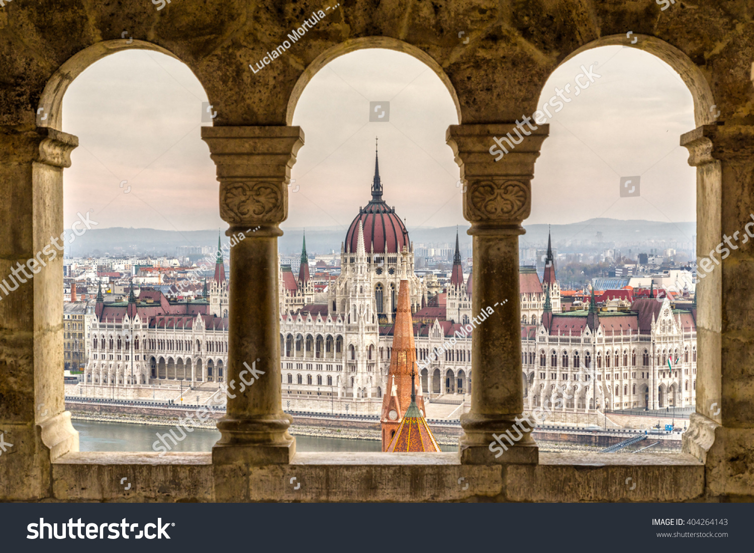budapest parliament view through fishermans bastion stock