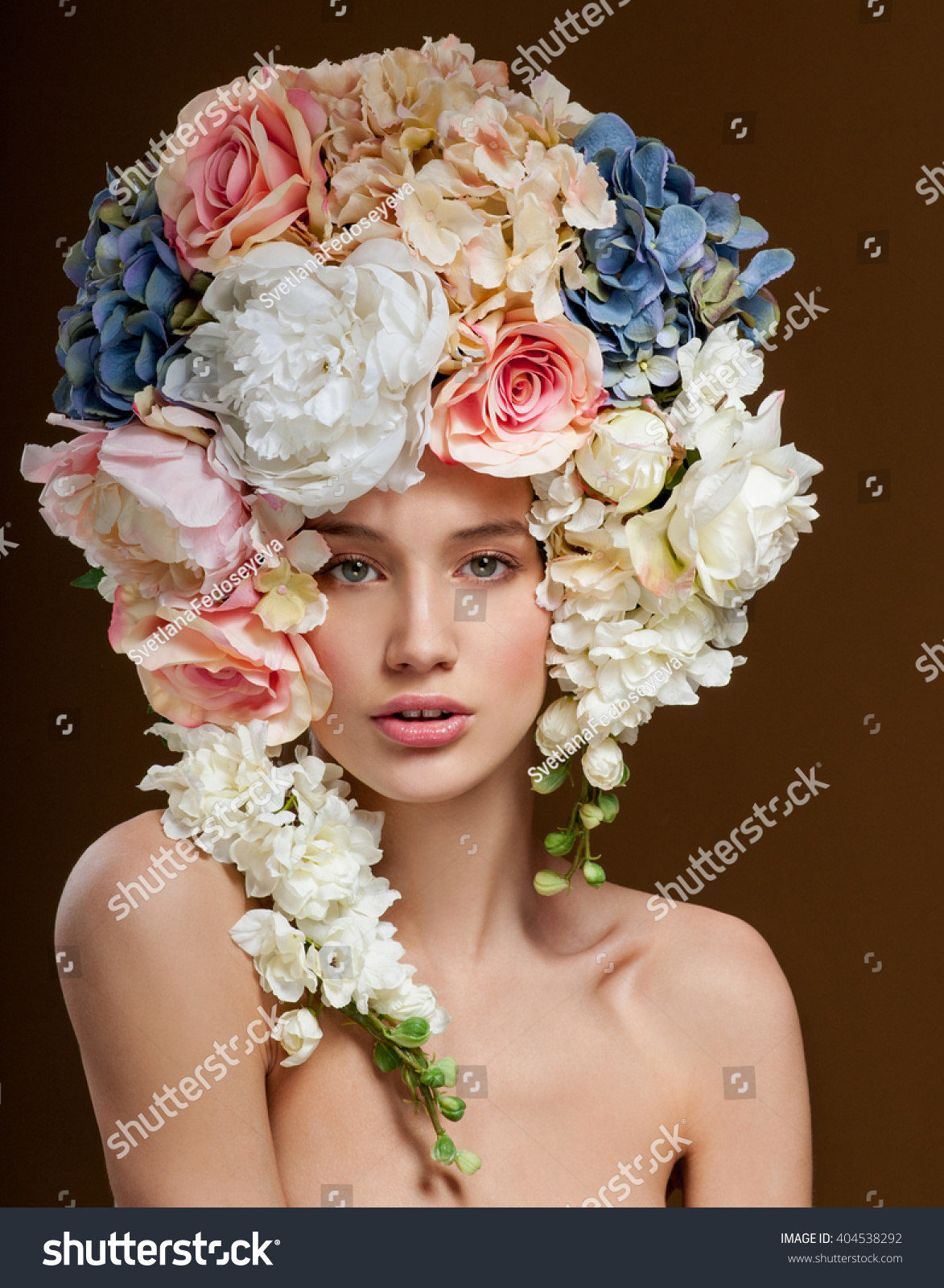 Beautiful woman flowers her hair bouquet stock photo royalty free beautiful woman with flowers in her hair bouquet of beautiful flowers hairstyle with flowers izmirmasajfo