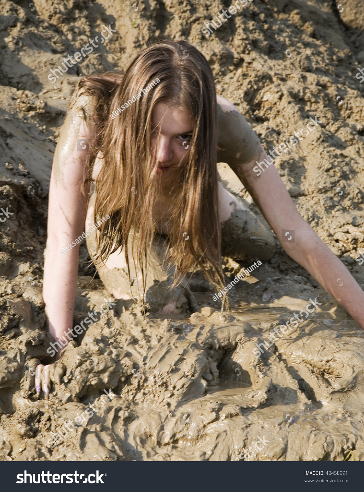 sexy nude girls playing in the mud