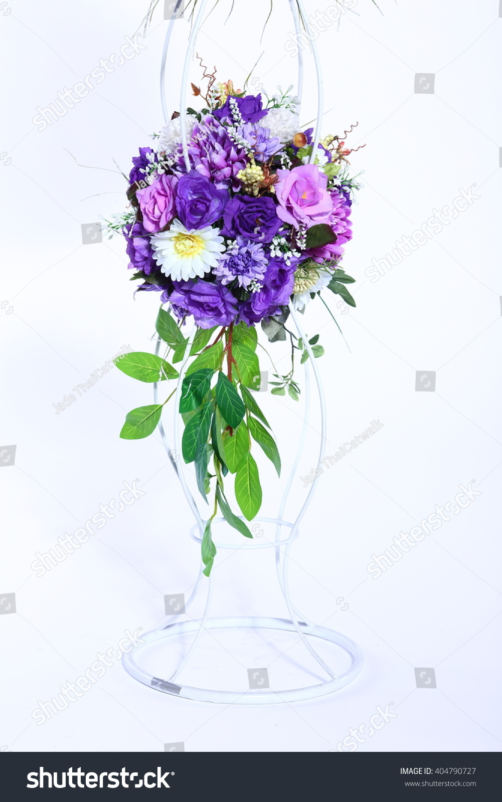 Assorted artificial flower bouquet purple shade stock photo royalty assorted artificial flower bouquet in purple shade color and kind of flowers on stand with leaf izmirmasajfo Images