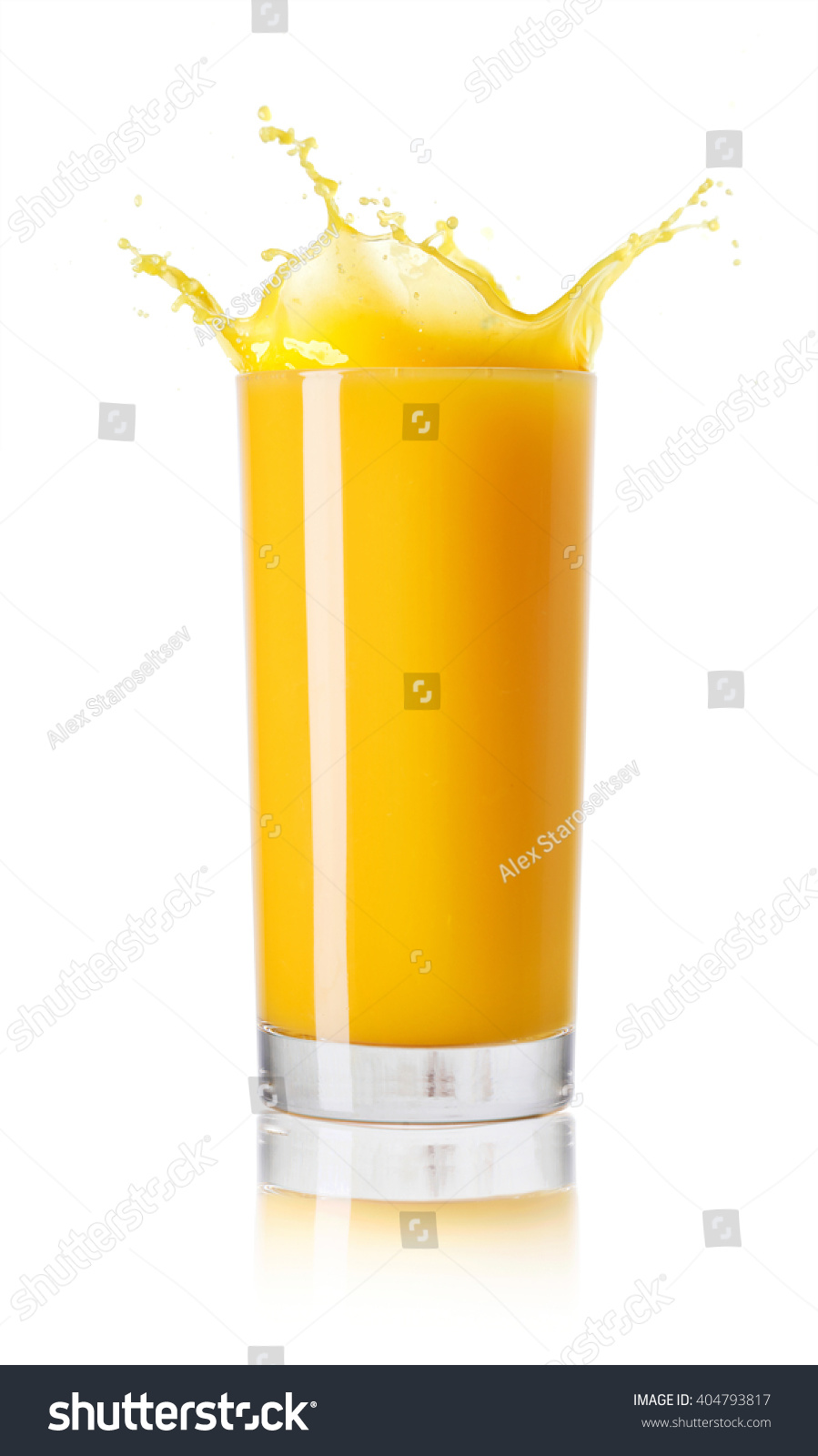 Orange juice in a glass on white background