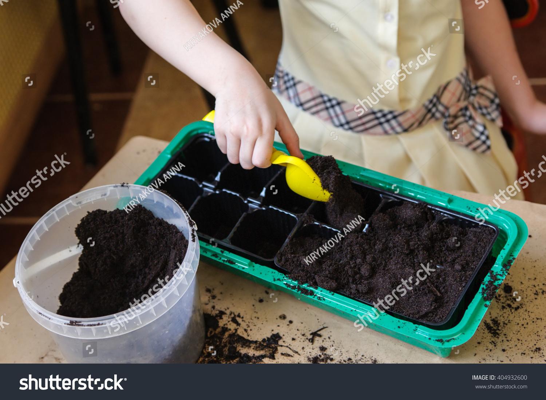 Girl holding yellow shovel soil she stock photo 404932600 for Soil yellow color