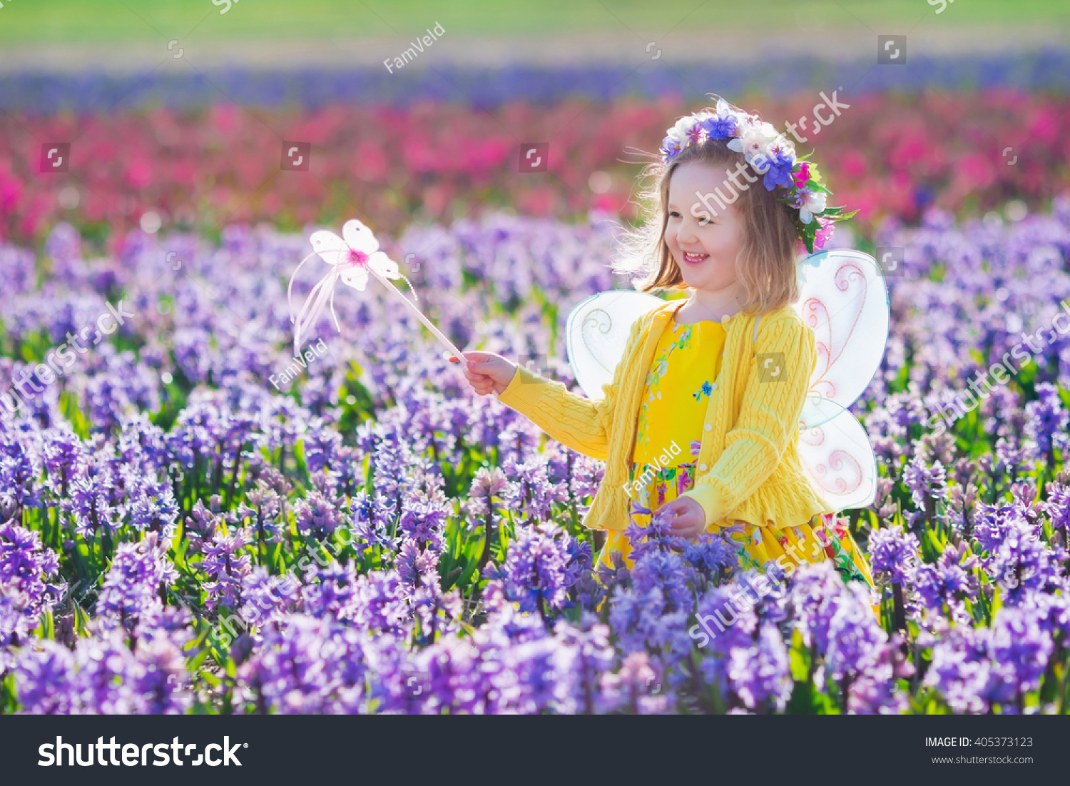 Royalty Free Beautiful Girl Playing In Blooming 405373123 Stock