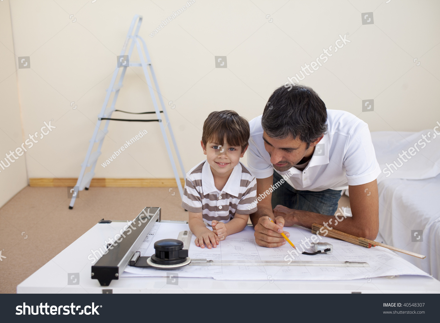 Happy Father And Son Studying Architecture At Home