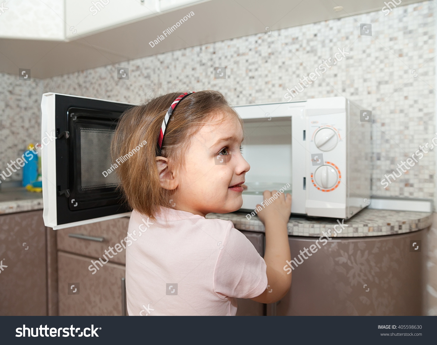 child out supervision of parents playing microwave stock save to a lightbox
