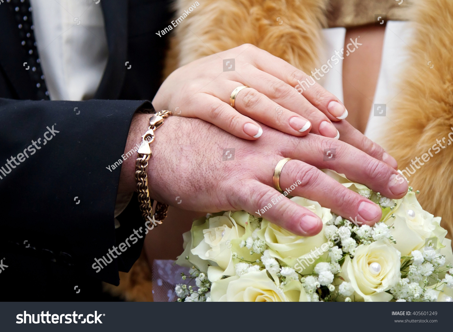 A man groom putting wedding ring on his brides finger in holy ...