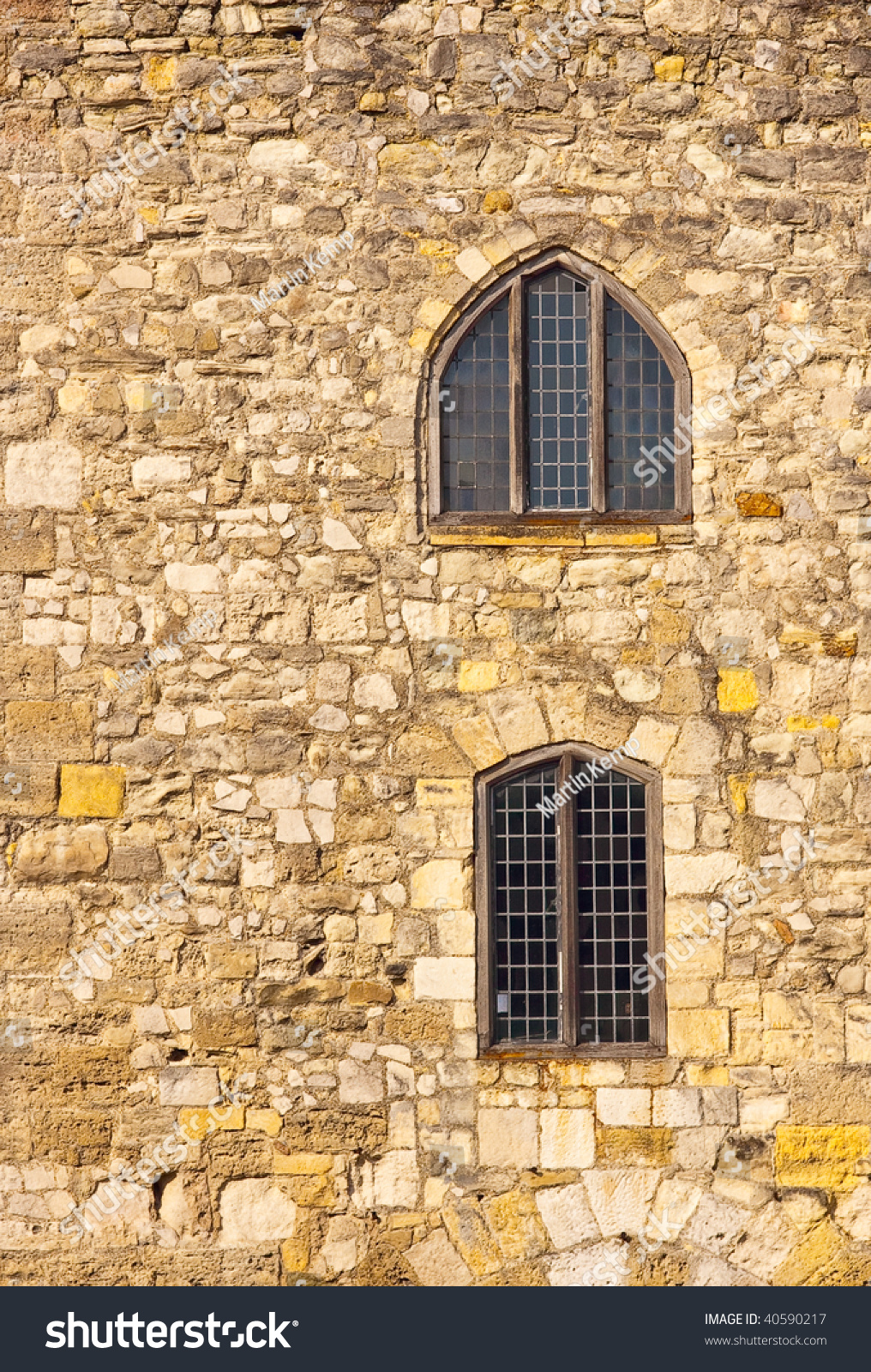 Stone Elevation Xp : Elevation of stone wall with windows stock photo