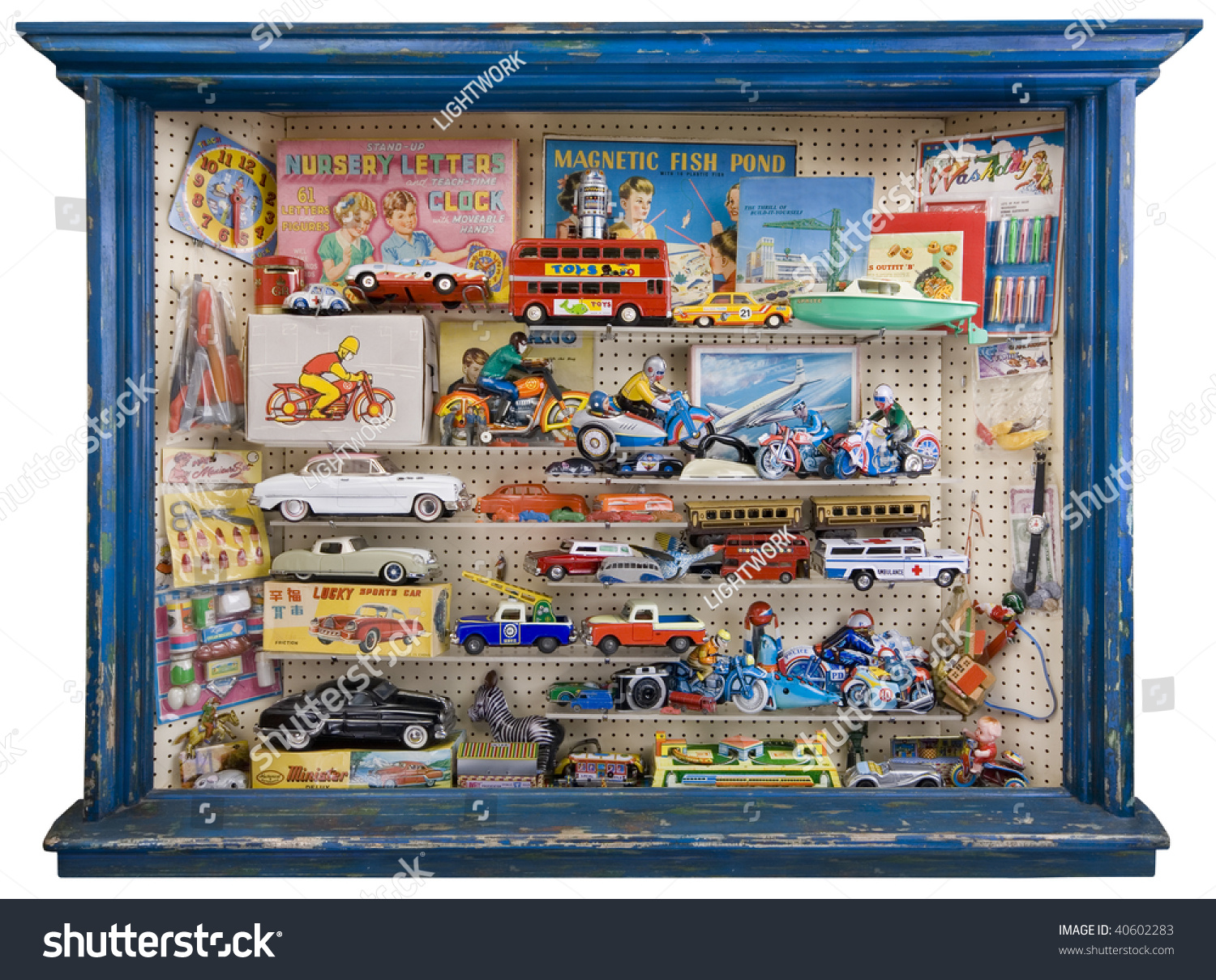 Classic Toys And Games : Toy shop window full tin plate stock photo