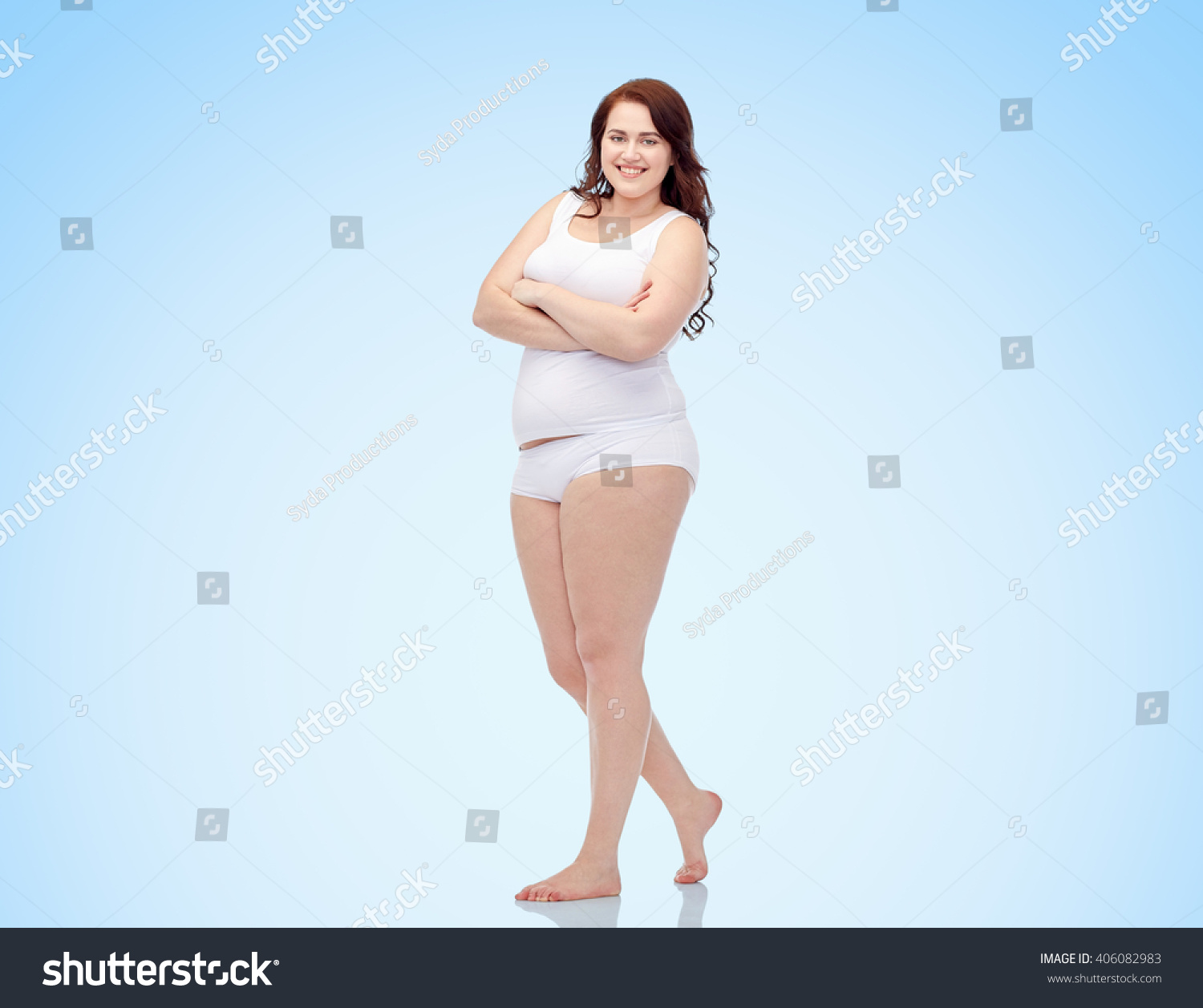 a7656bfe886 plus size and people concept - happy plus size woman in underwear over blue  background