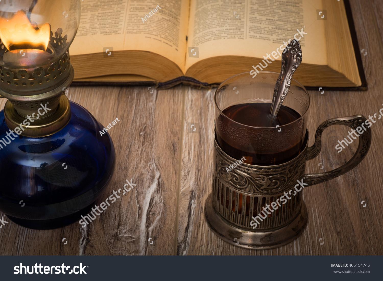 Tea drinking by the light of an old oil lamp glass oil for Wooden kerosene lamp holder