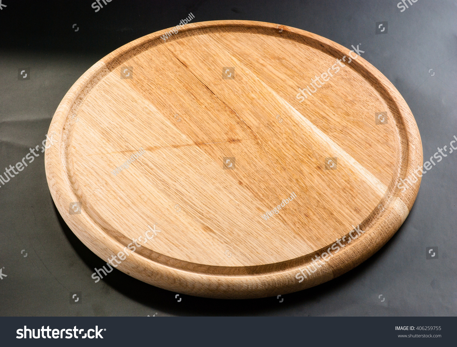Wooden Round Cutting Board On Black Stock Photo Edit Now 406259755