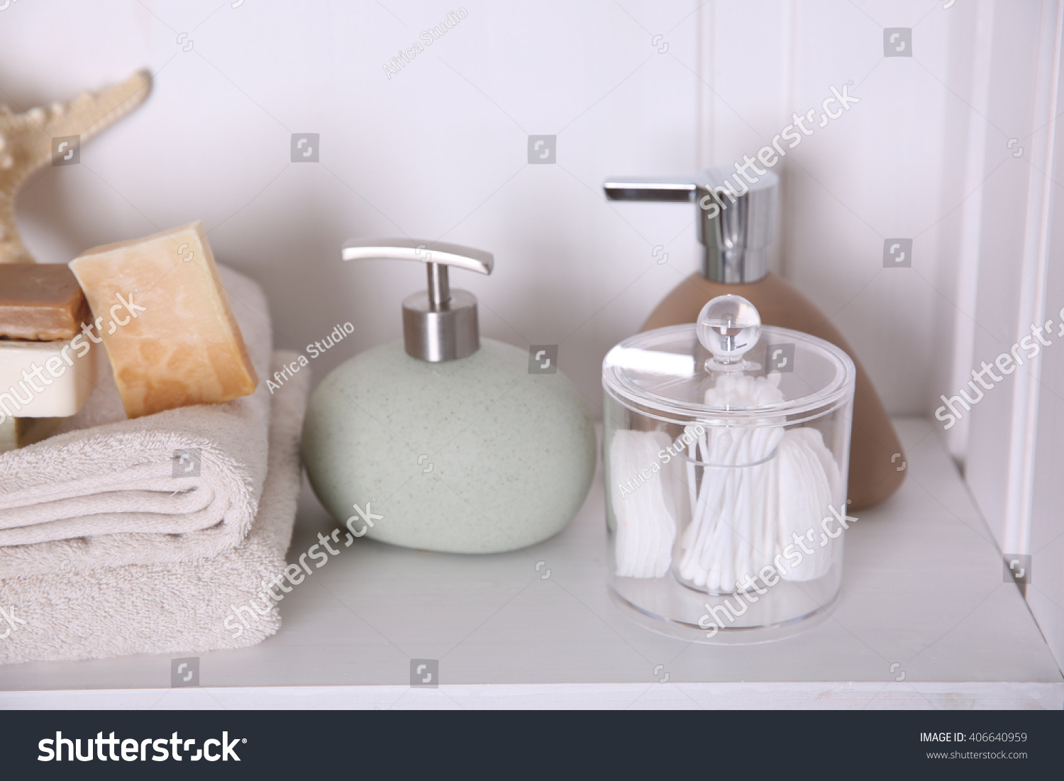 Bathroom set with towels, soap and starfish on a light shelf | EZ Canvas