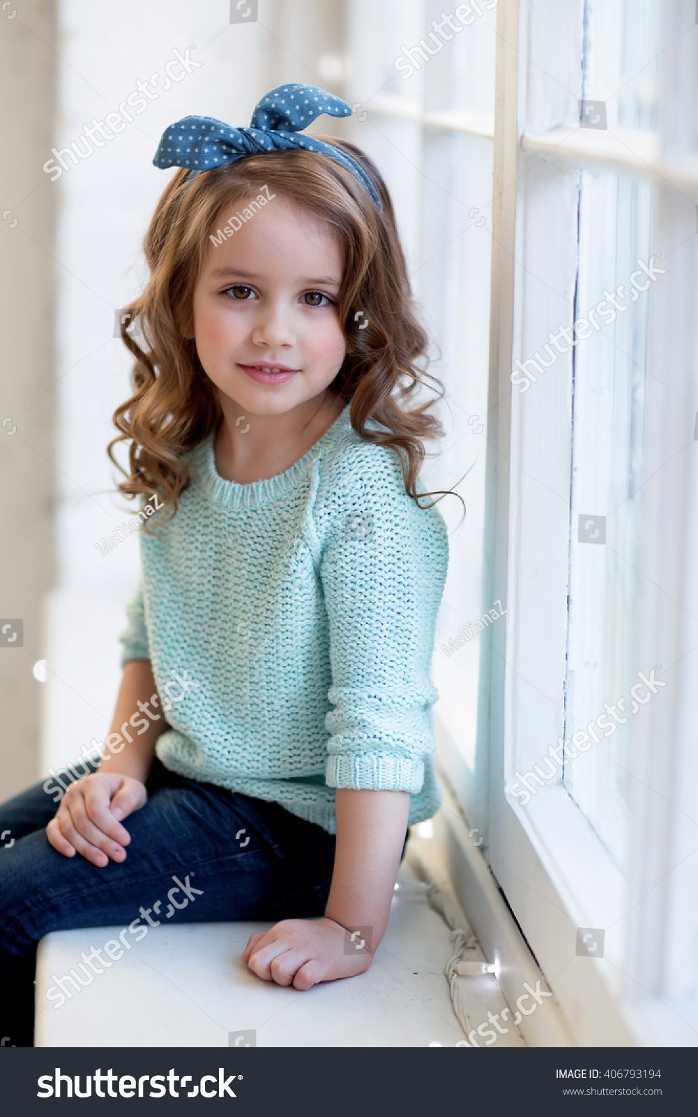 Beautiful Girl Curly Hair Sits On Stock Photo 406793194 - Shutterstock