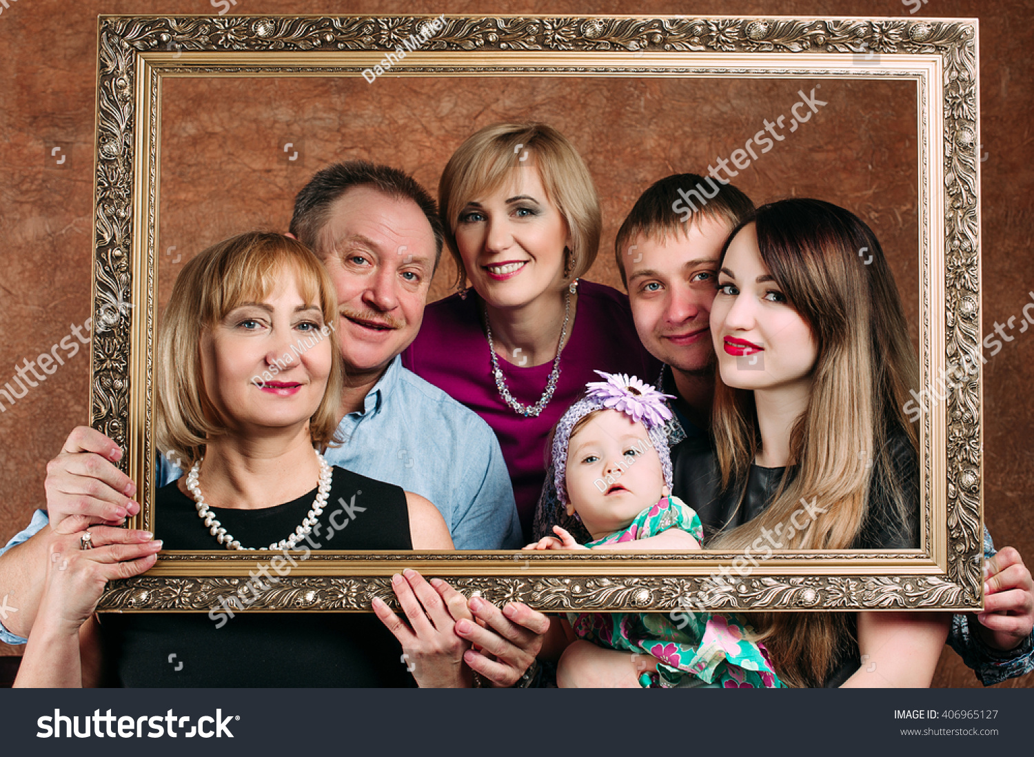 three generation family sitting on sofa together classic portrait in a frame 406965127