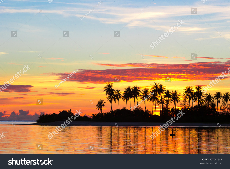 Tropical Island Beach Ocean Sunset: Dark Silhouettes Palm Trees Amazing Cloudy Stock Photo