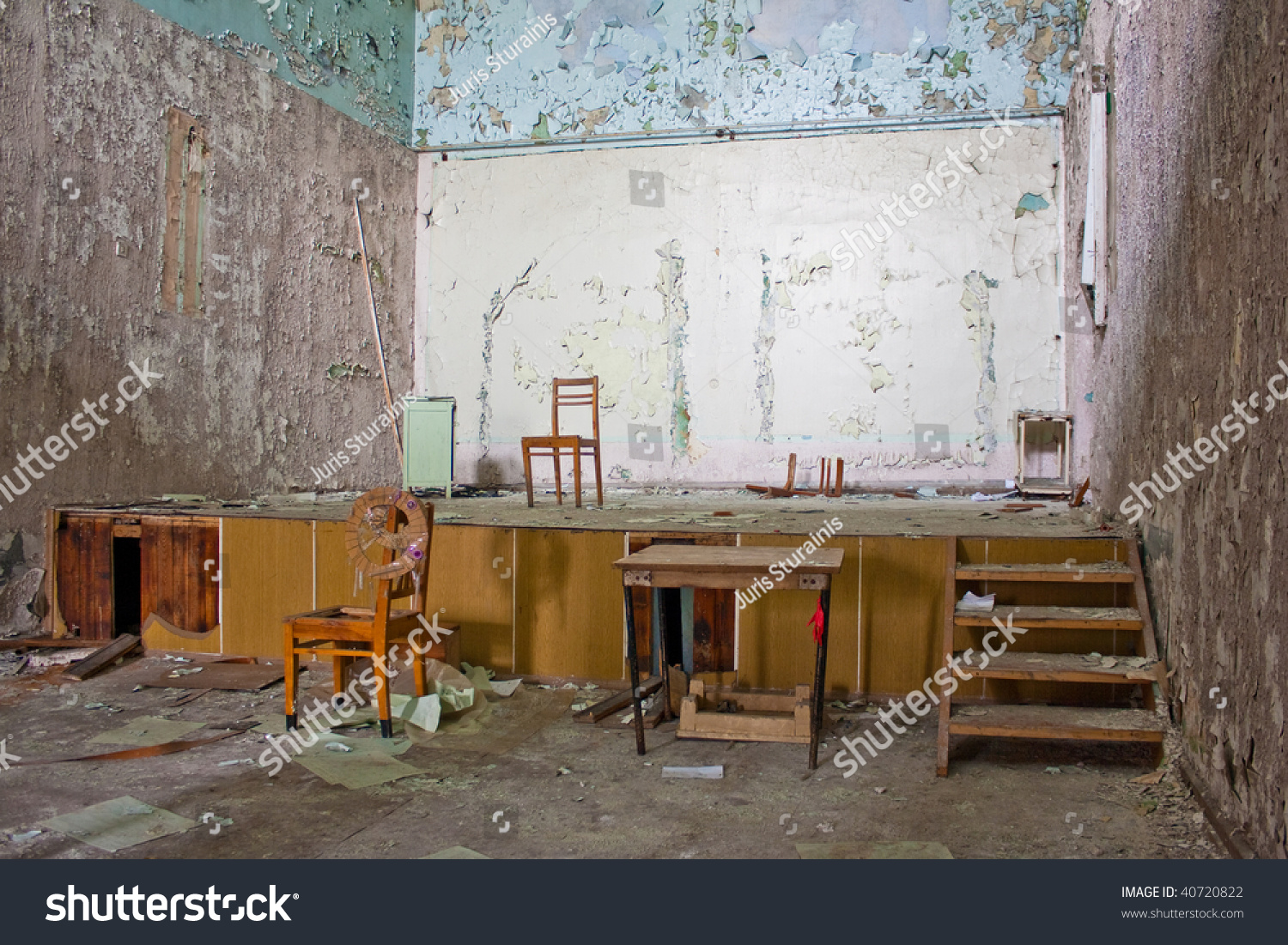 Old Abandoned Messy Room With A Stage Stock Photo