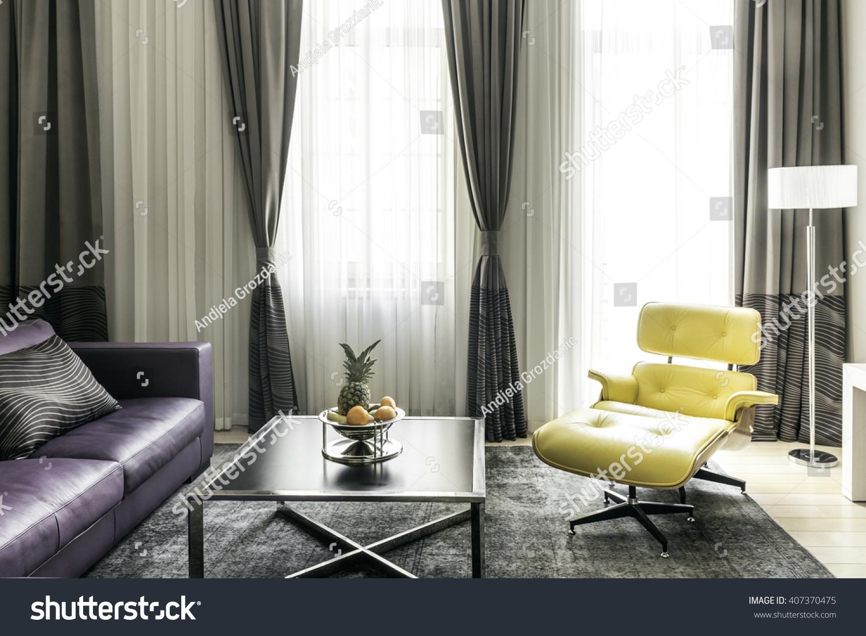 Modern Yellow And Gray Living Room Interior Stock Photo
