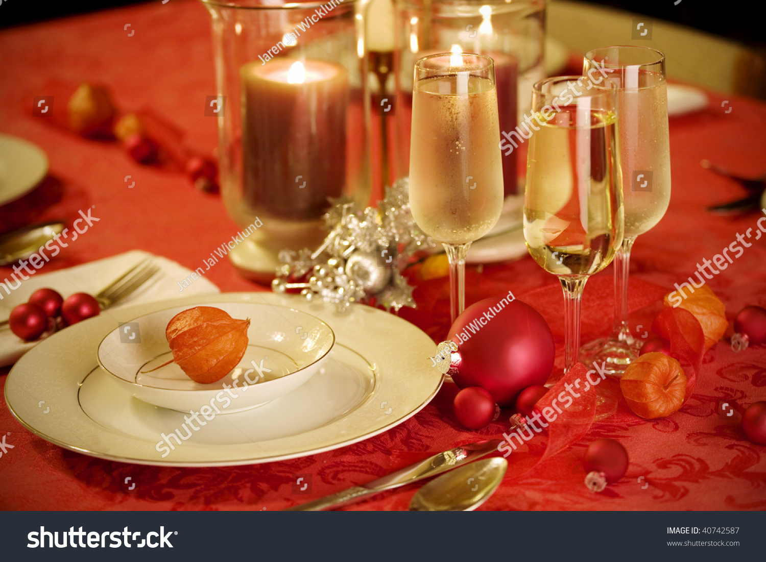 Elegant Christmas table setting in red and gold colors with red Japanese lantern flower as & Elegant Christmas Table Setting Red Gold Stock Photo (Royalty Free ...