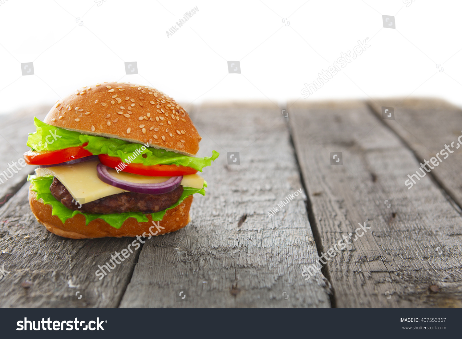 Burger hamburger cheeseburger on table wooden stock photo for Table burger