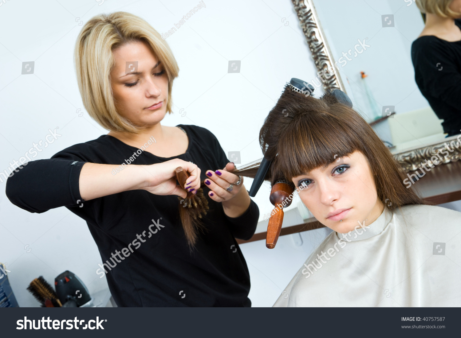 Hair Stylist Woman Brushes Her Hair Stock Photo Edit Now 40757587