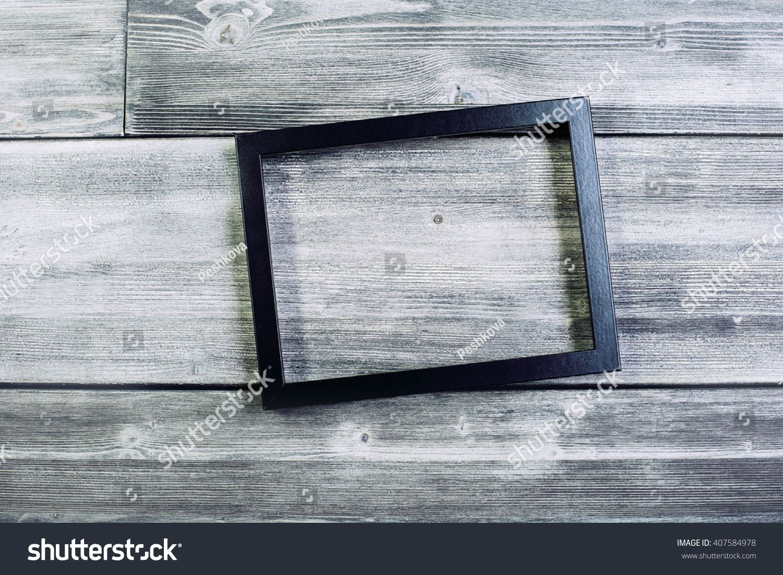 Black Seethrough Frame On Wooden Wall Stock Photo 407584978 ...