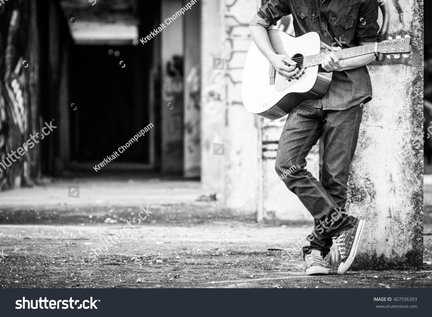 Male With Acoustic Guitar Outdoor Black And White Photo
