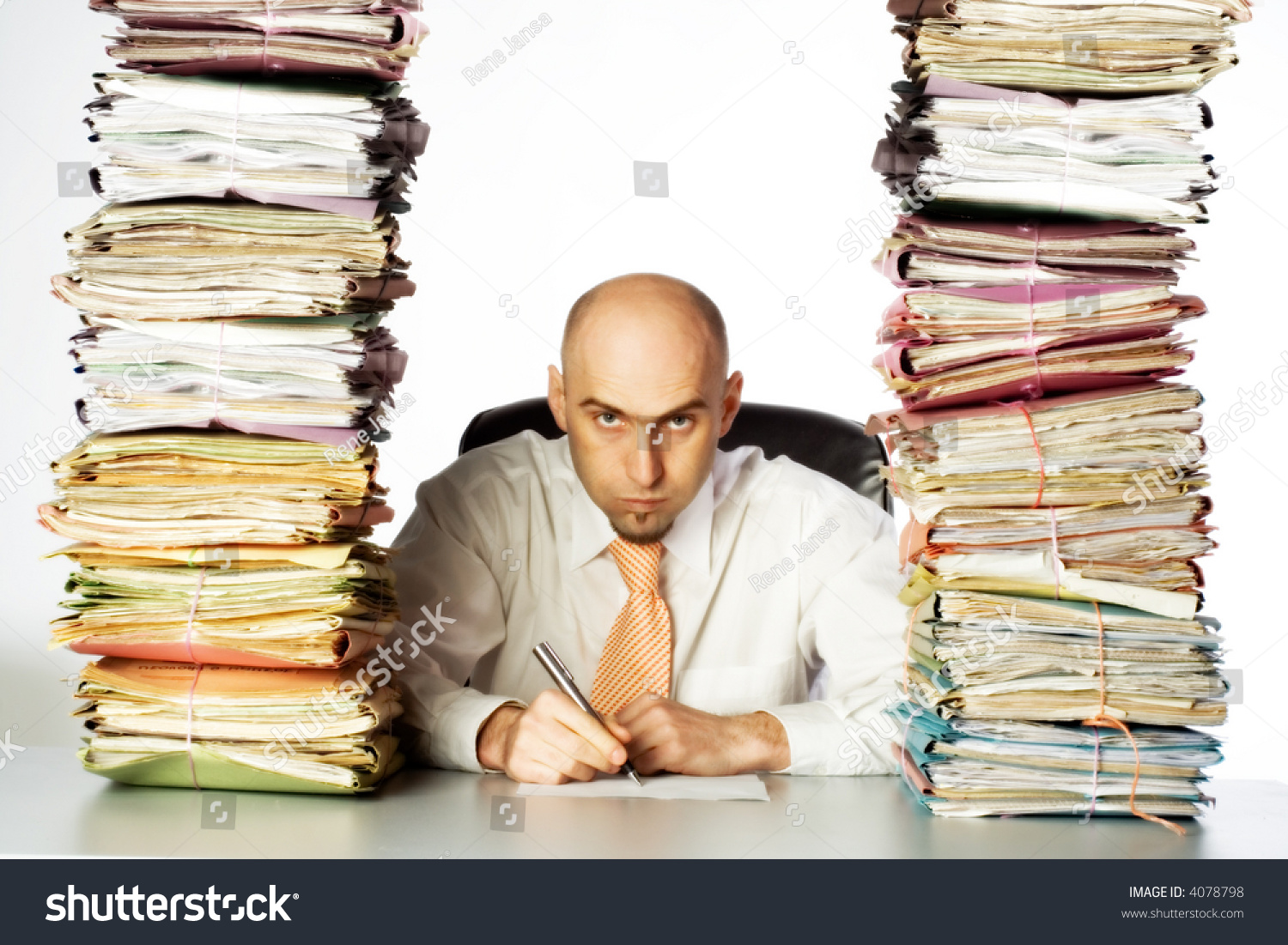 stern unpleasant administrative clerk glares through stock photo a stern and unpleasant administrative clerk glares through two huge stacks of business files clearly