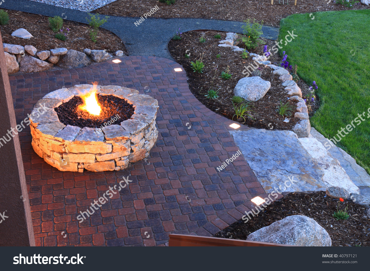 Awesome Backyard With Fire Pit And Illuminated Paver Patio ...