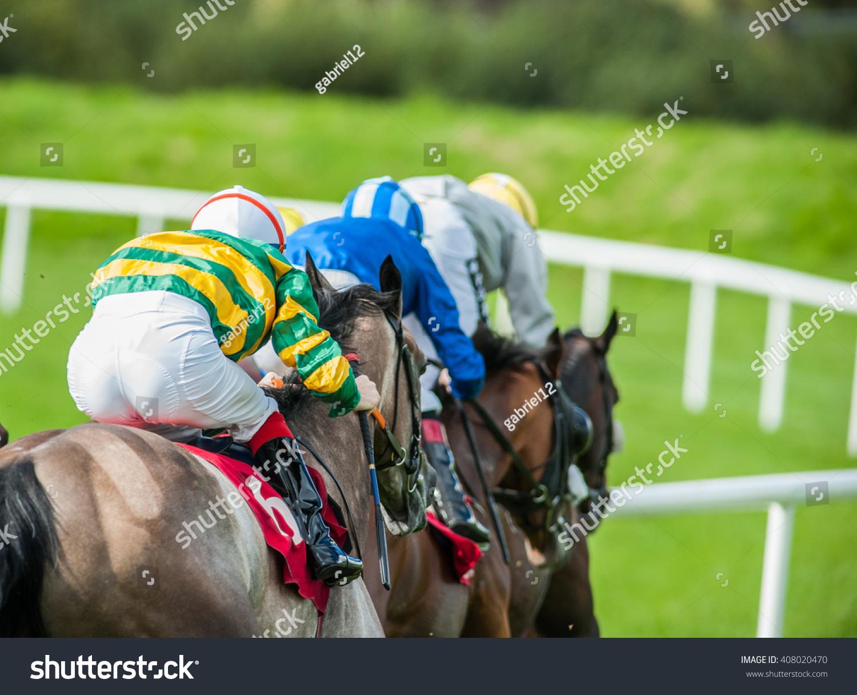 Race Horses Jockeys Racing Down Track Stock Photo