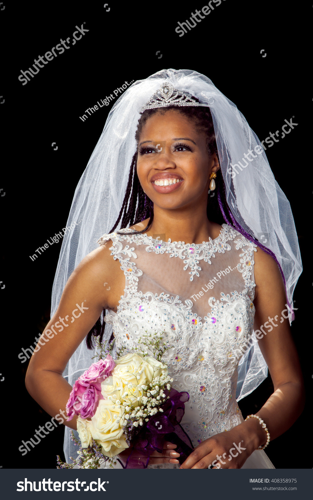 https://image.shutterstock.com/z/stock-photo-portrait-of-a-beautiful-african-american-bride-on-her-wedding-day-black-background-with-a-back-408358975.jpg