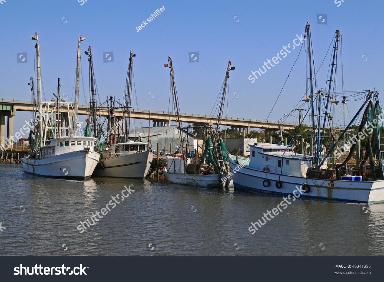 Fishing boats moored on the savannah river stock photo for Fishing charters savannah ga