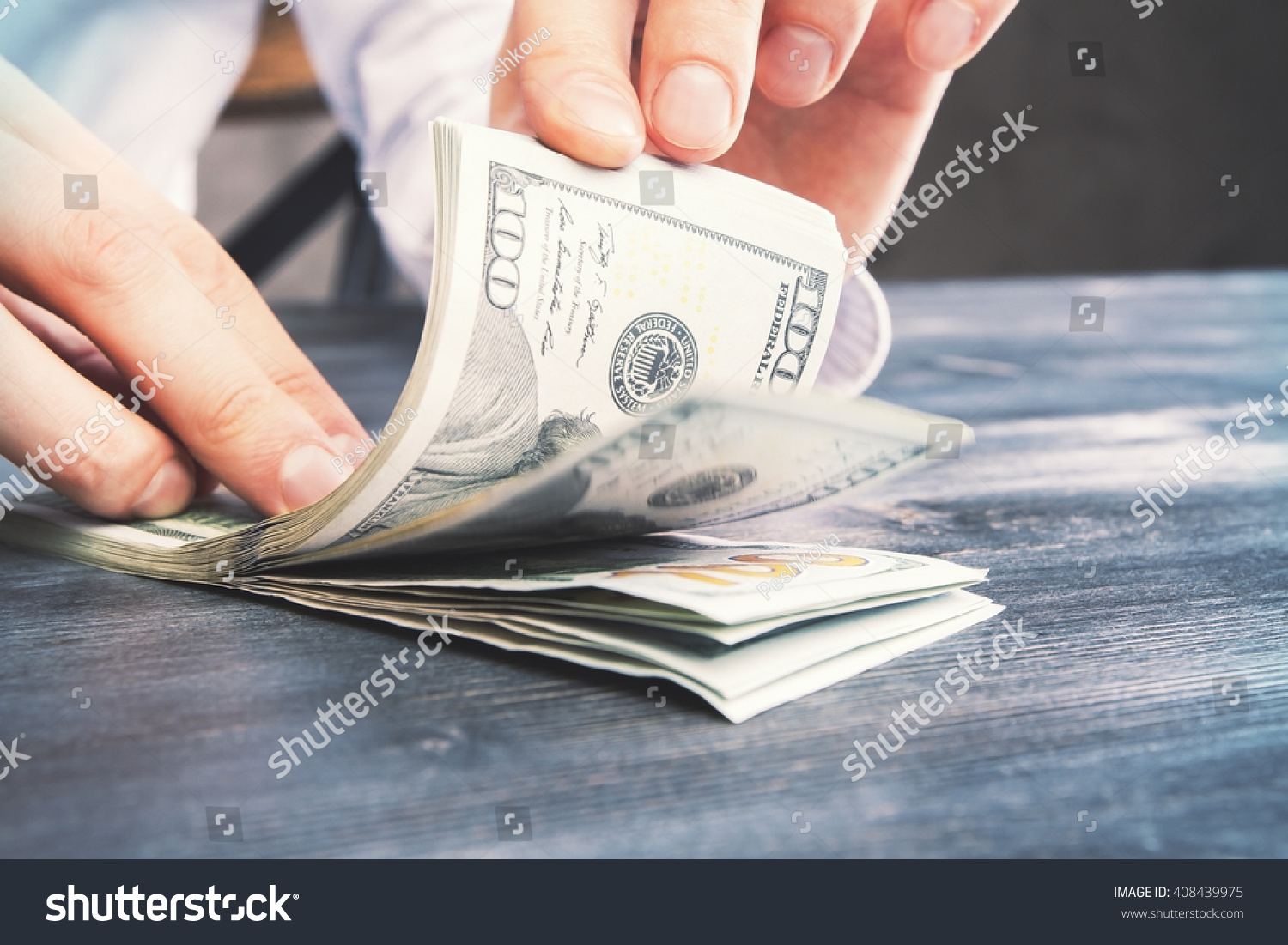 worksheet Counting Dollar Bills caucasian hands counting dollar bills on stock photo 408439975 darw wooden table