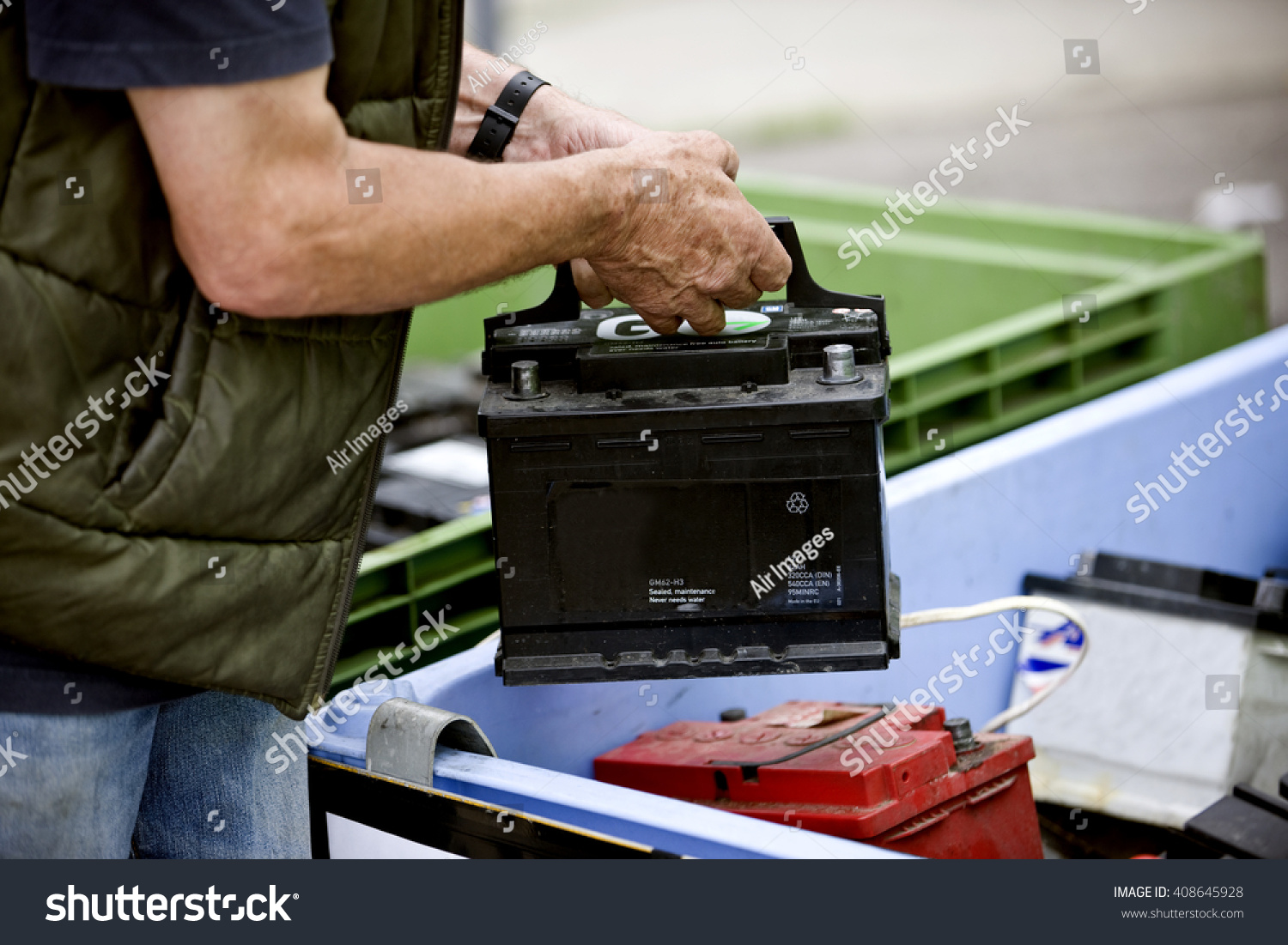 senior man recycling car battery stock photo 408645928 shutterstock. Black Bedroom Furniture Sets. Home Design Ideas