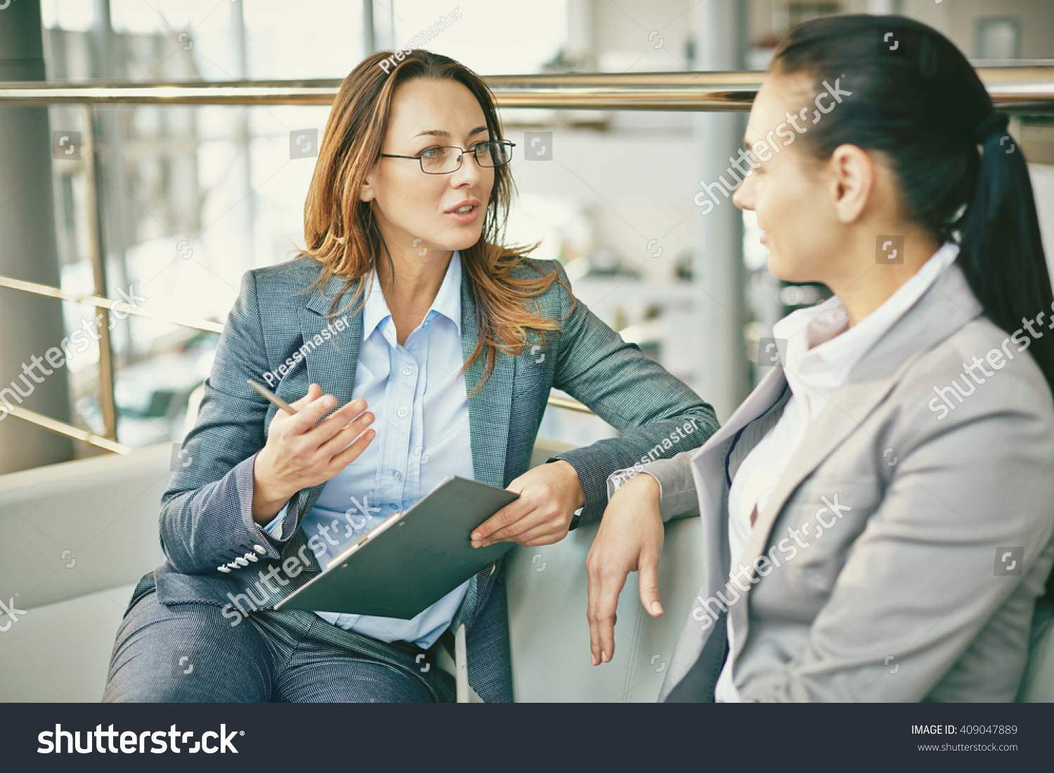 hr manager asking questions female candidate stock photo  hr manager asking questions to female candidate