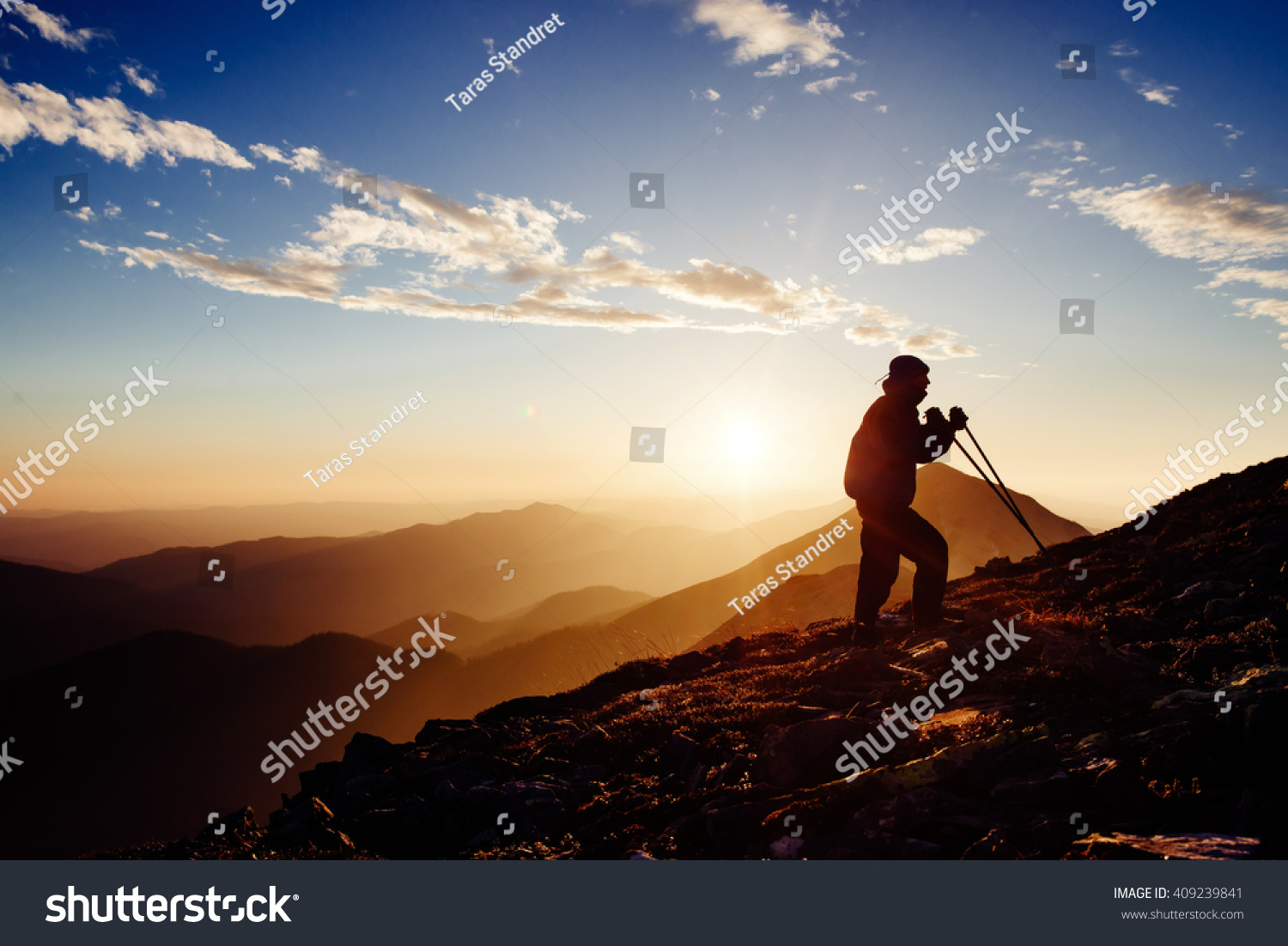 Tourist Travels Peak Mountain Rock Sunny Stock Photo - This man hikes up the transylvanian mountains every morning to photograph sunrise