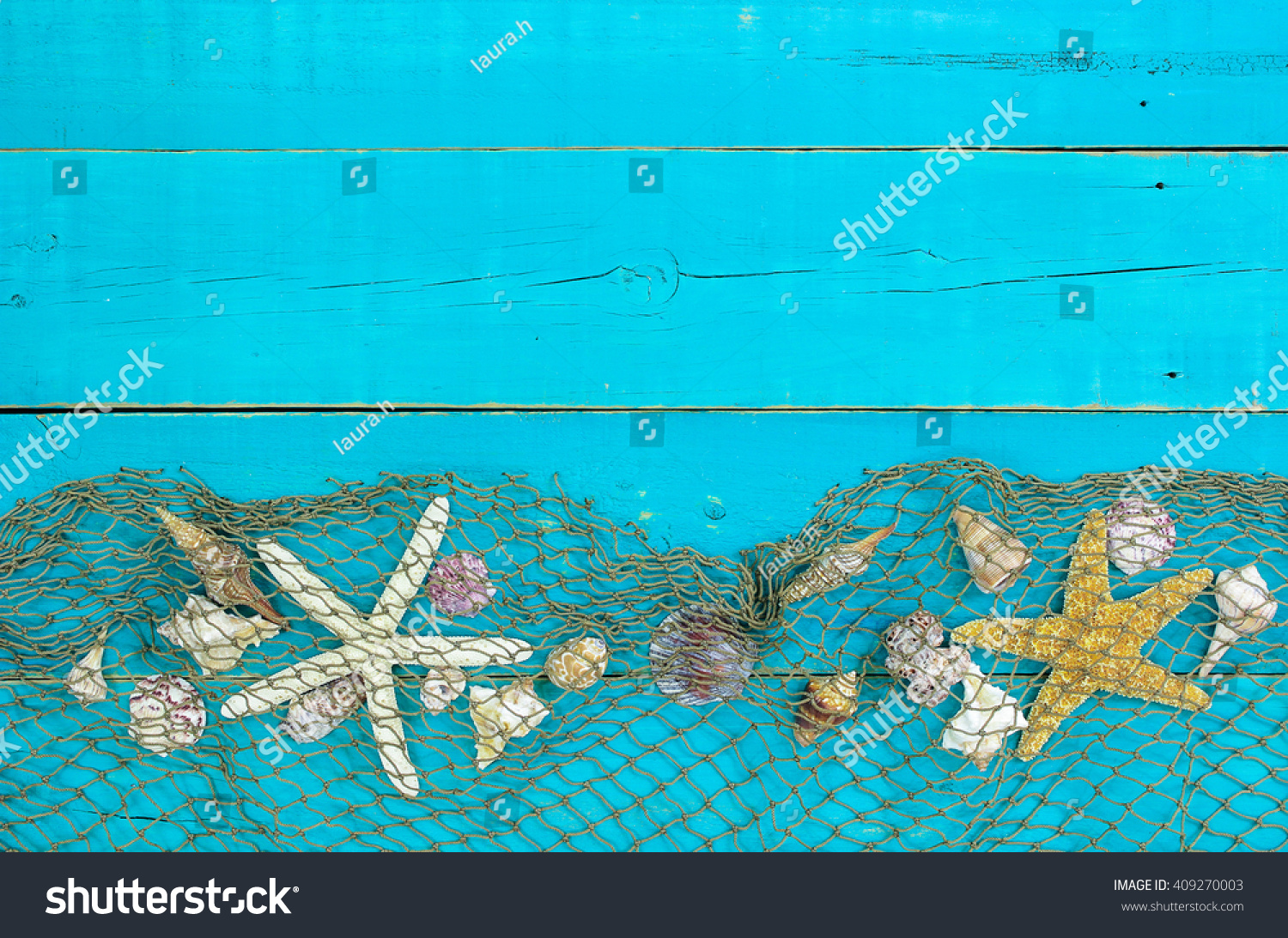 Seashells Starfish And Fish Net Border On Antique Rustic Teal Blue Wood Background Blank Beach Sign With Painted Wooden Copy Space Stock Photo