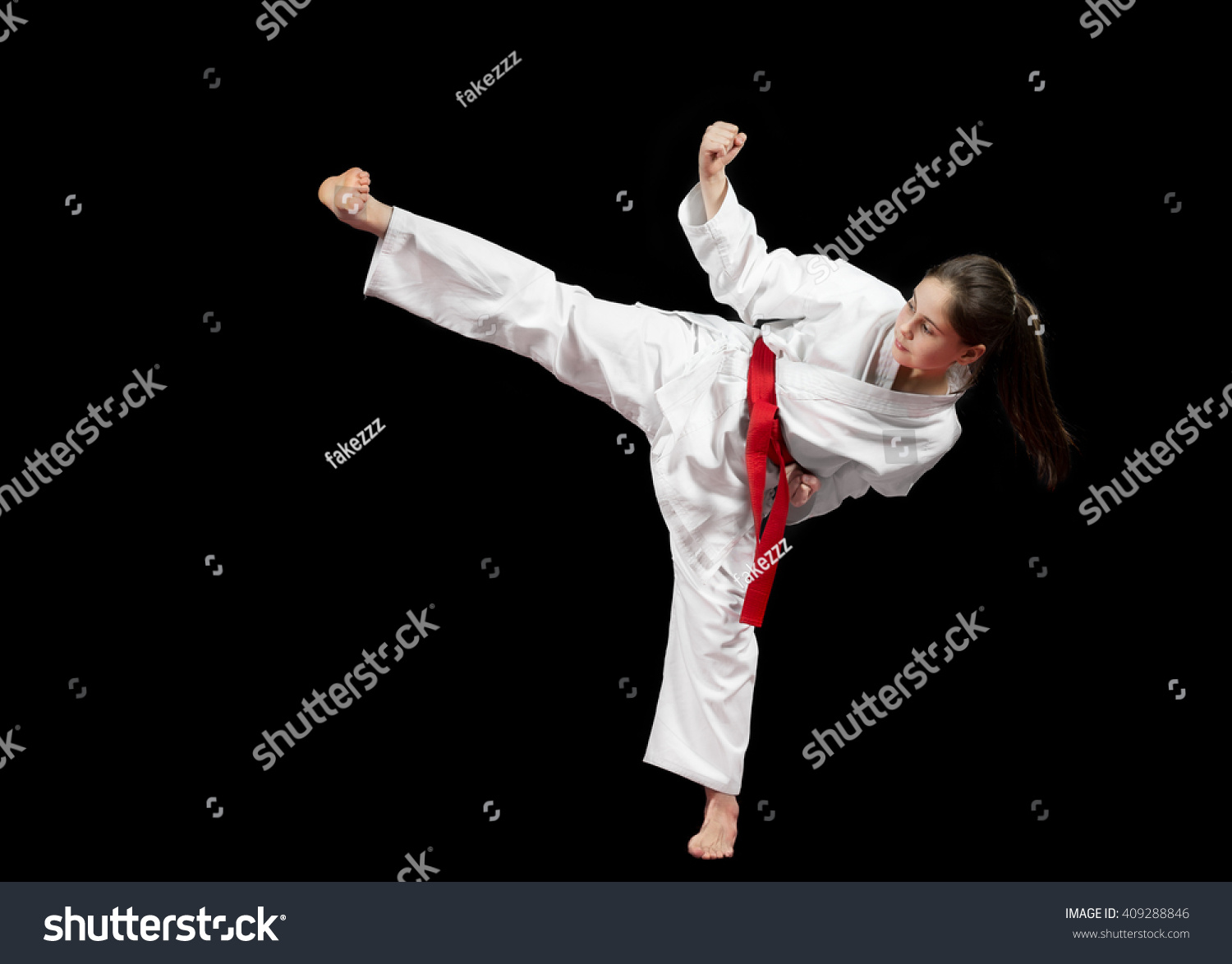 Young Girl Preforming Karate Martial Arts. Stock Photo ...