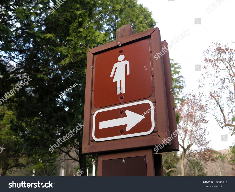 Gender Neutral Symbol For Restroom In A Park Stock Photo
