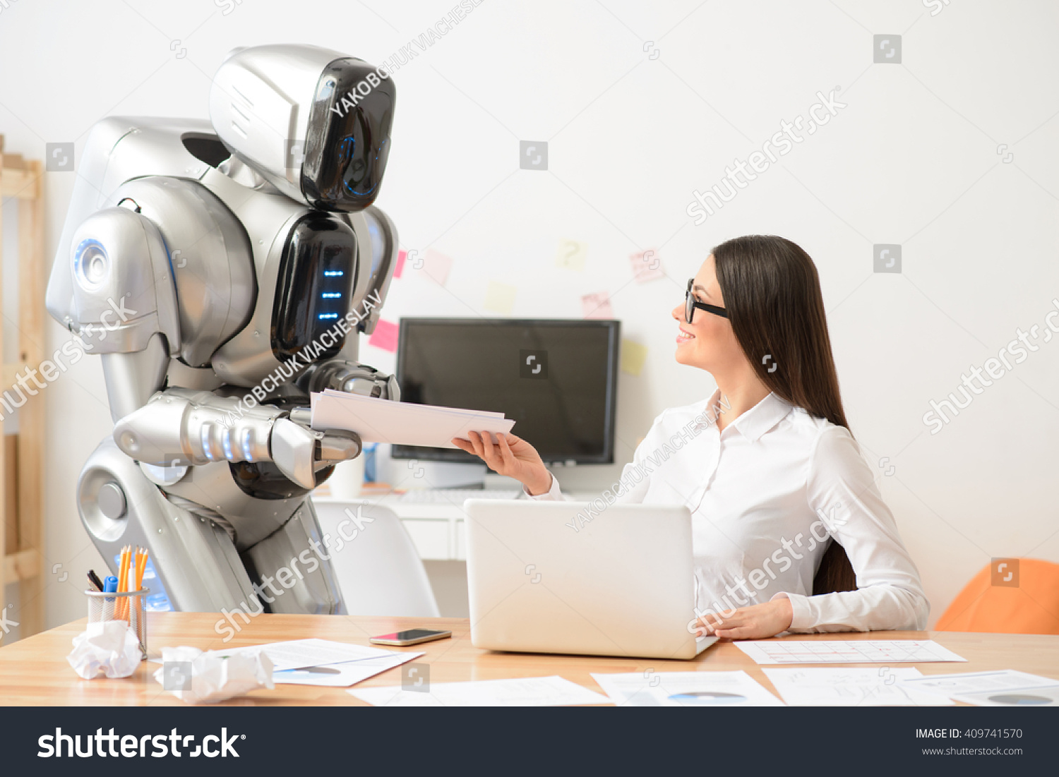 nice girl and robot working in the office person