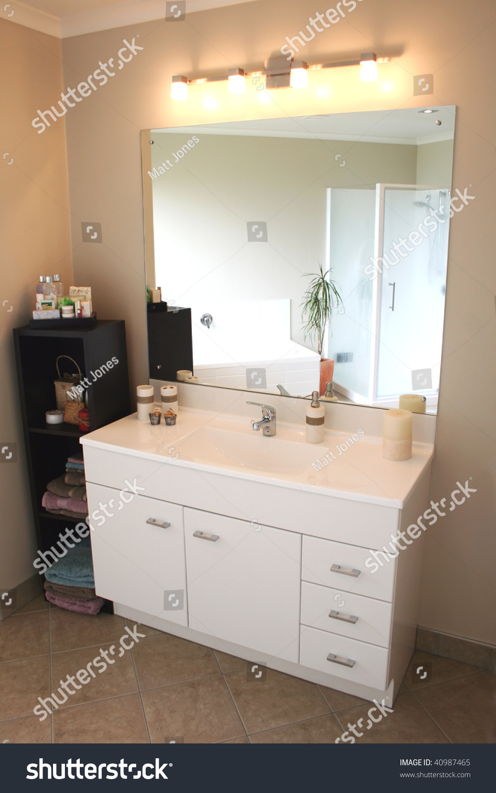 A white and stainless steel modern bathroom vanity mirror and accessories. Bathroom Cabinets With Drawers