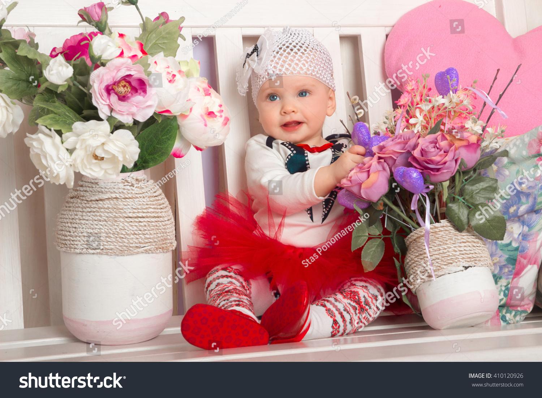 cute baby girl blue eyes sitting stock photo (edit now) 410120926