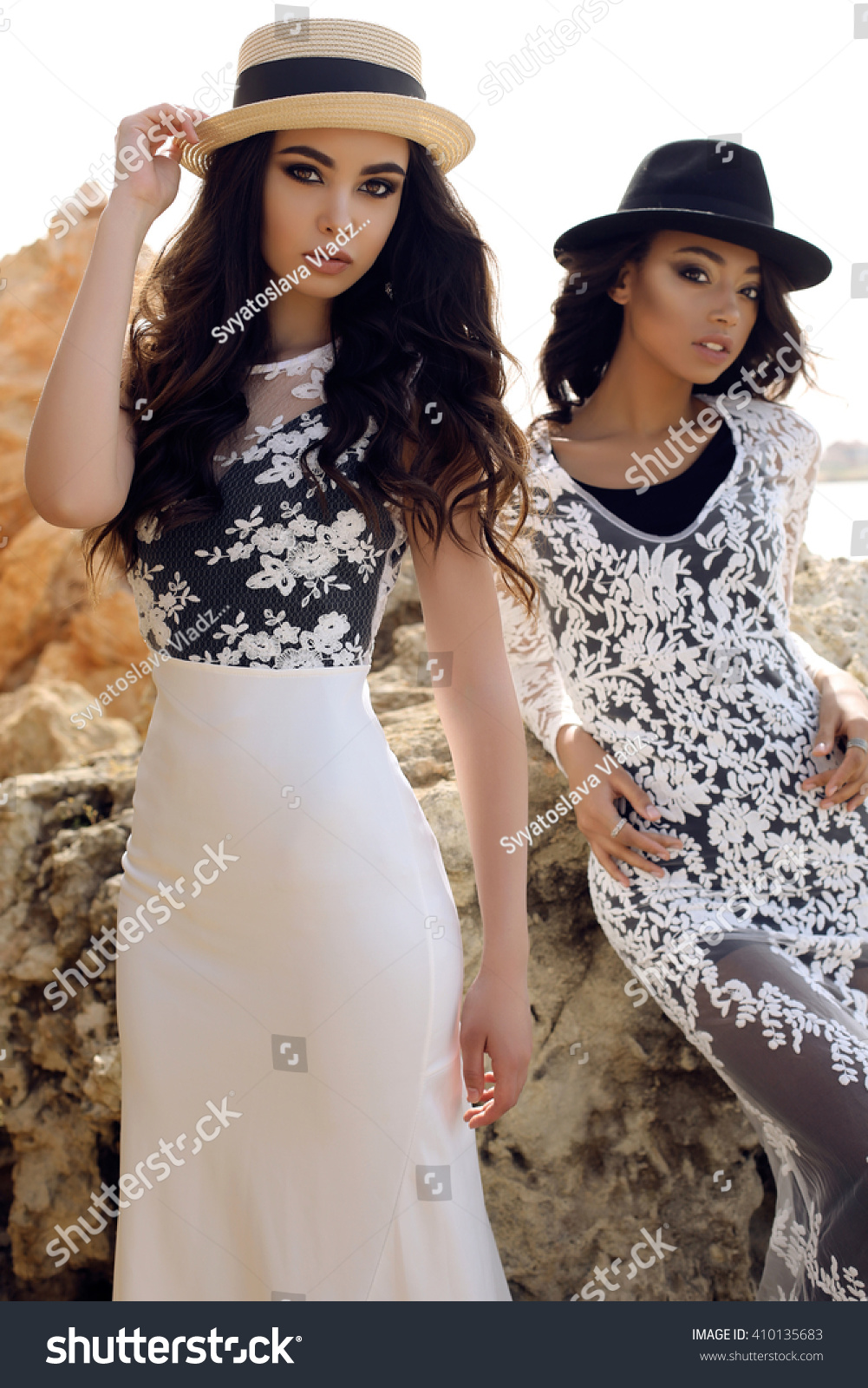 aee7610d302 Fashion outdoor photo of beautiful girls with dark hair wears casual  elegant clothes and hat posing at summer seacoast