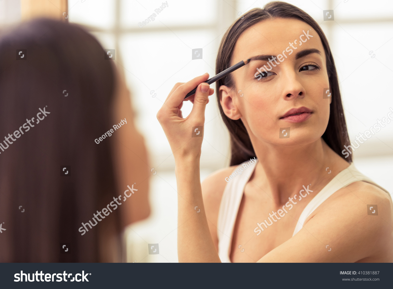 Beautiful Girl Doing Makeup Retouching Eyebrows Stock Photo Edit