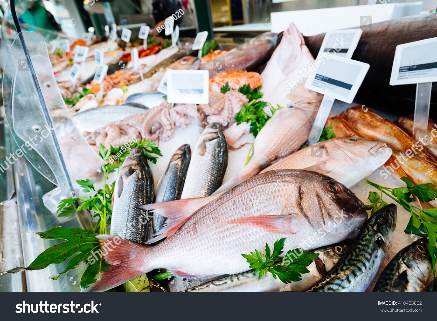 Fresh seafood on ice fish market stock photo 410403862 for Seafood fish market