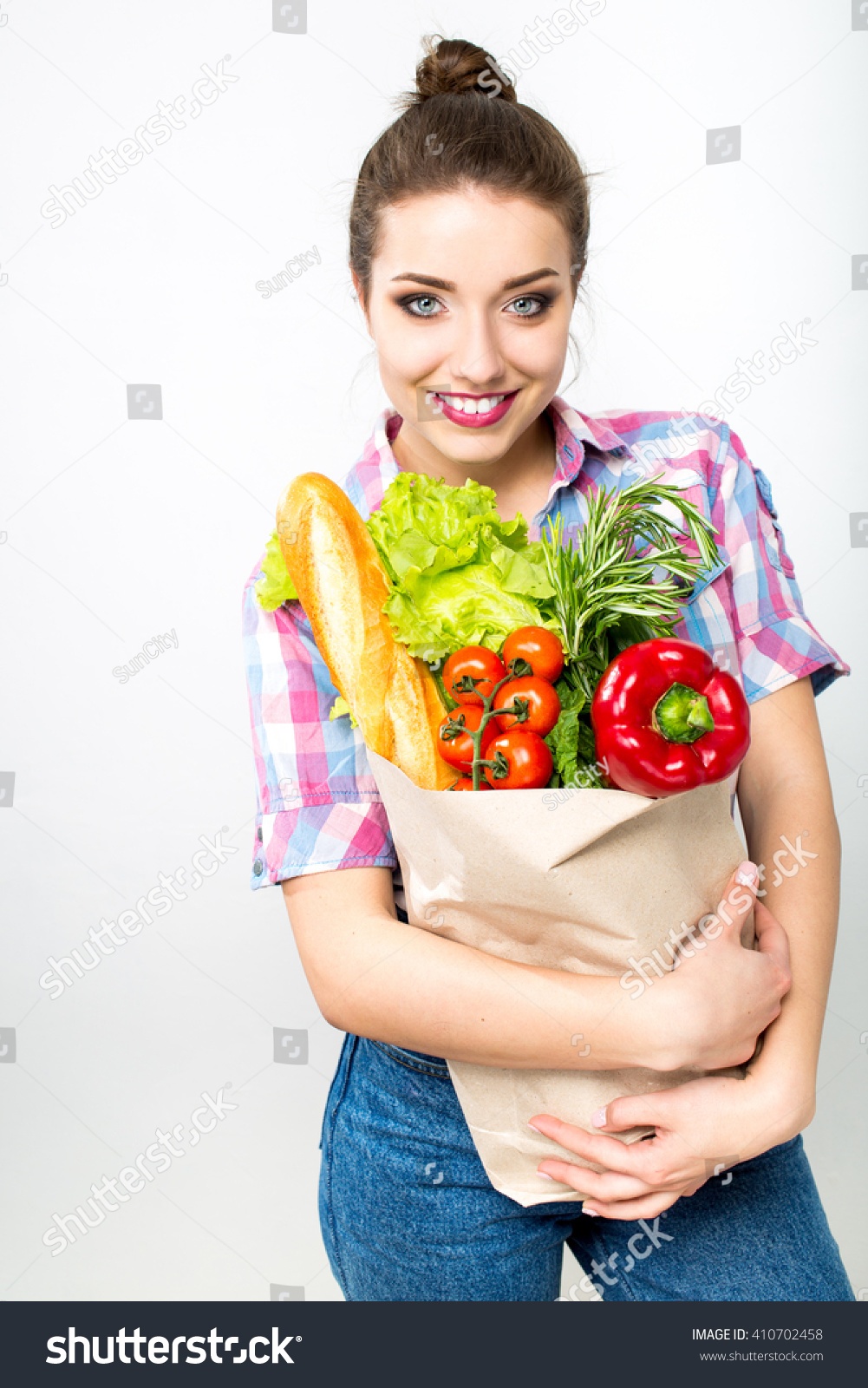 Woman posing with shopping bags isolated on white background full - Woman Holding A Shopping Bag Full Of Fresh Food Isolated Over White Background