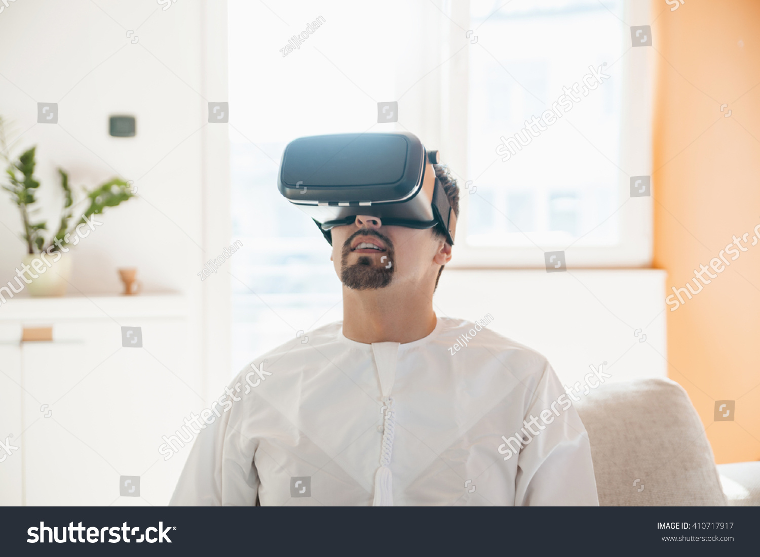 0a1542706b6 Arabian Man Using VR Headset Home Stock Photo (Edit Now) 410717917 ...