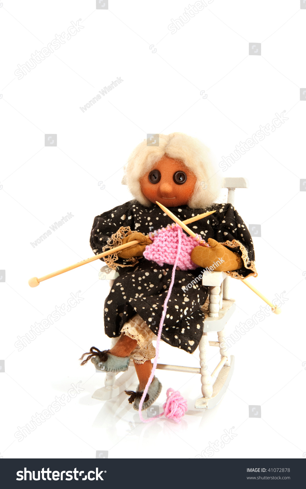 Knitting Grandma Sitting In A Rocking Chair Stock Photo