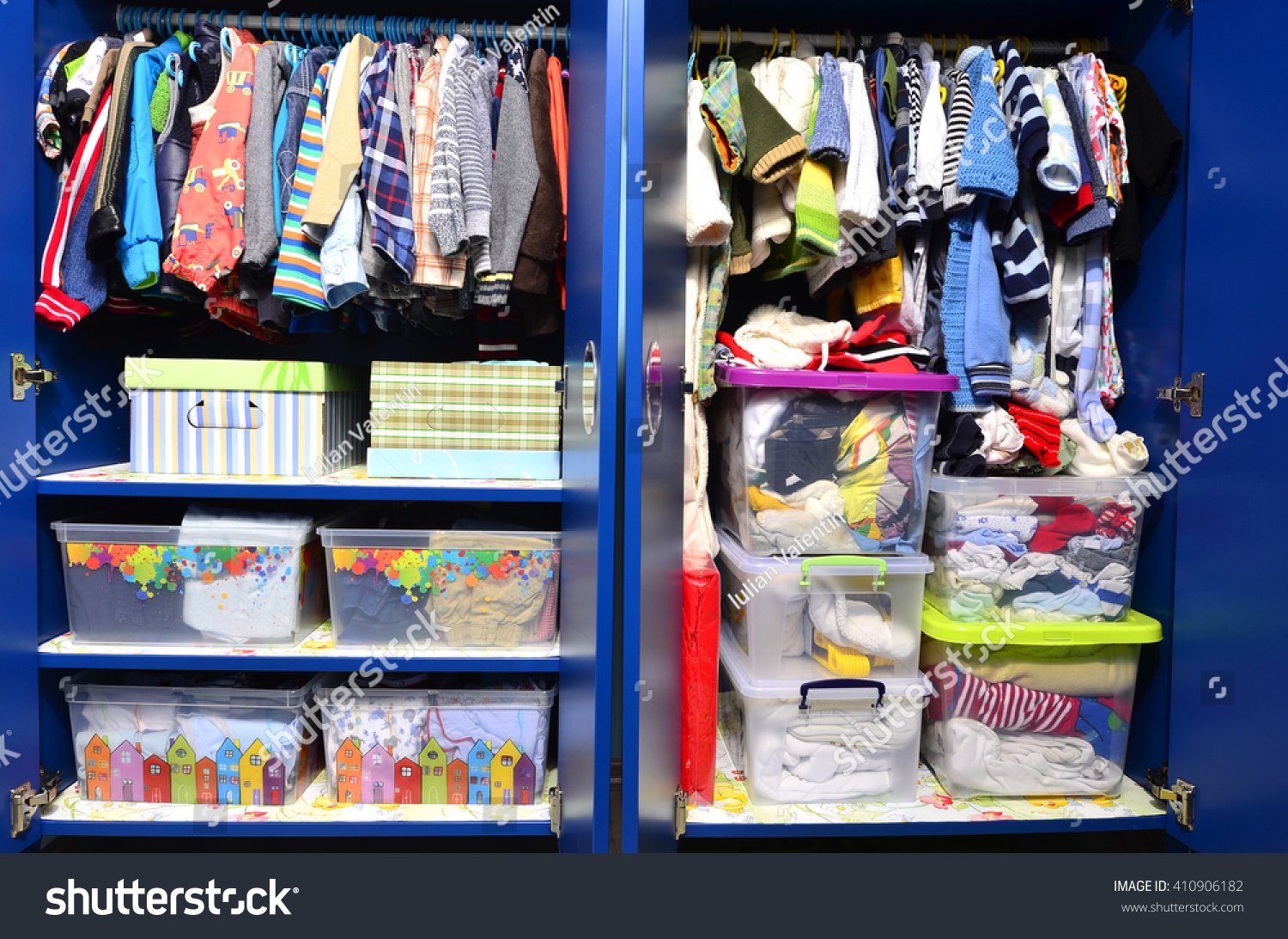 Dressing Closet For Kids With Clothes Arranged On Hangers.Colorful Wardrobe  Of Newborn,kids