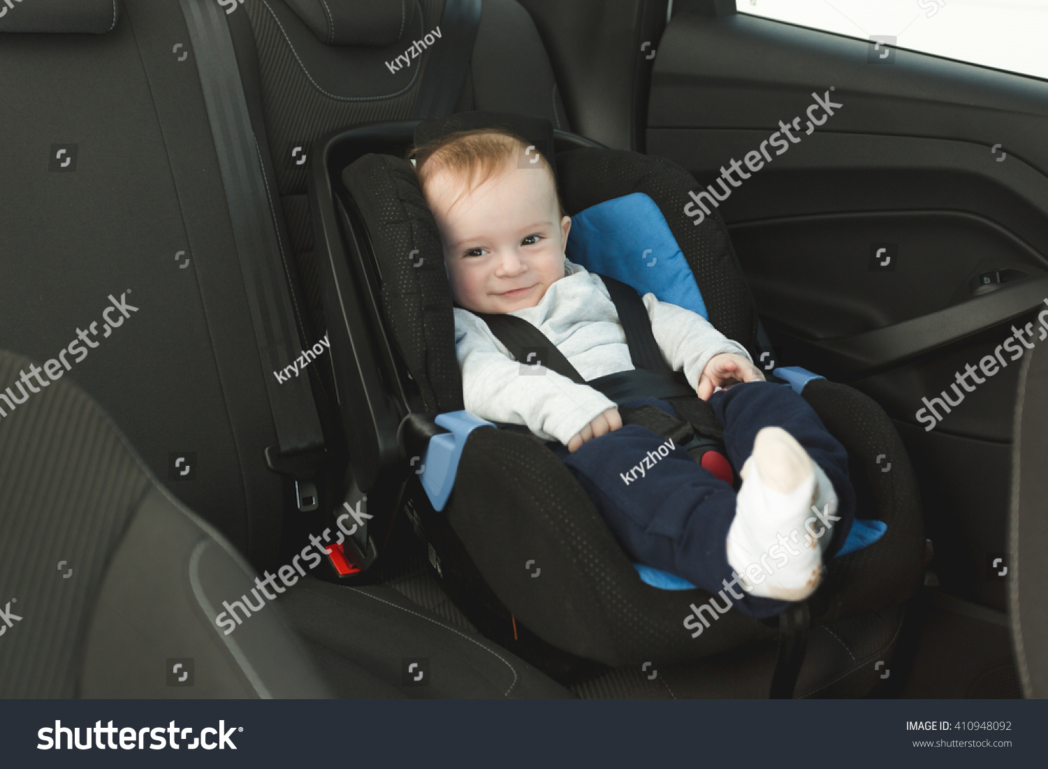 Cute 6 Months Old Baby In Car Child Seat