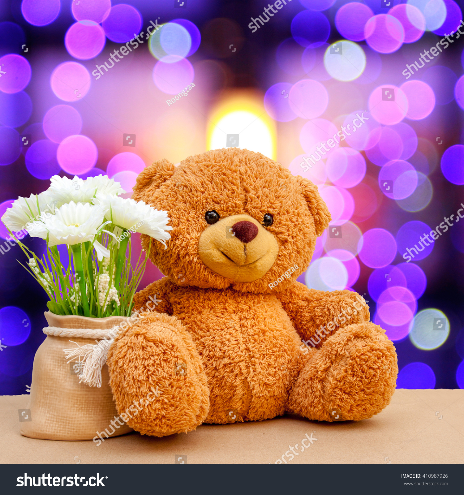 nice cute teddy bear blured background stock photo (royalty free